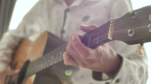 close-up hand playing guitar - string stock videos and b-roll footage