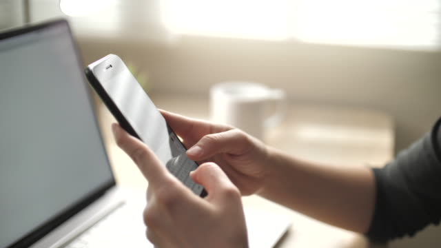 close-up hand text messaging on smart phone, close-up of technology in use - text messaging video stock e b–roll