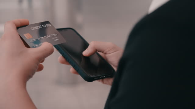 close-up hand touch the mobile phone to buying shopping online. - electronic banking stock videos & royalty-free footage