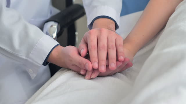 close-up, hand touching to hand help express empathy encourage tell diagnosis at medical. - emotional support stock videos & royalty-free footage