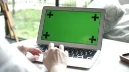 Close-up Hand Using Laptop with Green screen