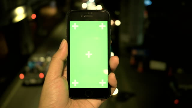 close-up : hand using mobile phone at night - scrolling stock videos & royalty-free footage