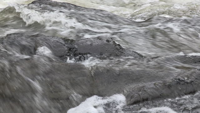 close-up, handheld sequence showing white water and rocky banks of the river spean, argyllshire, scotland. - rapid stock videos & royalty-free footage
