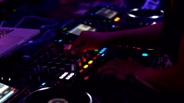 Close-up. Hands of DJ Decks Turntable mixer console at Disco Party Nightclub for celebration event