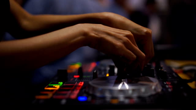 close-up. hands of dj decks turntable mixer console at disco party nightclub for celebration event - record player stock videos & royalty-free footage