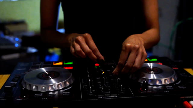 close-up. hands of dj decks turntable mixer console at disco party nightclub for celebration event - dj stock videos & royalty-free footage