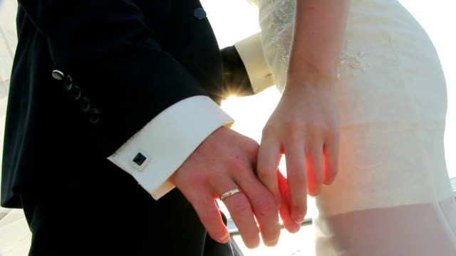 close-up - hands of the bride and groom