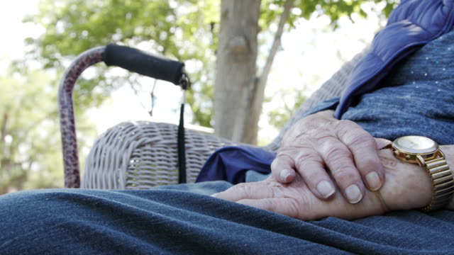 close-up hands shot of a 90 plus year-old elderly senior caucasian woman's hands outdoors in the summer - 80 89 years stock videos & royalty-free footage