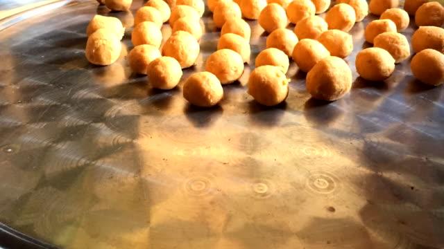 close-up hands woman making thai deep fried sweet potato balls - fried potato stock videos and b-roll footage