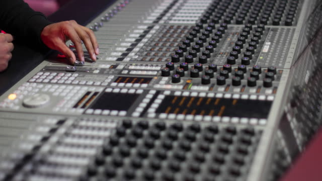 closeup hands working a control mixer in a recording studio - radio studio stock videos & royalty-free footage