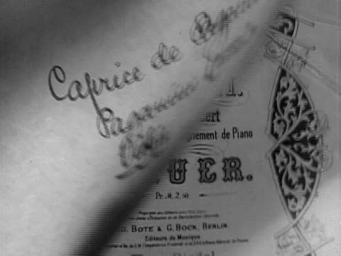 closeup handwriting on program for caprice de paganini for violin with accompaniment by piano by leopold auer/ usa - symbol stock-videos und b-roll-filmmaterial