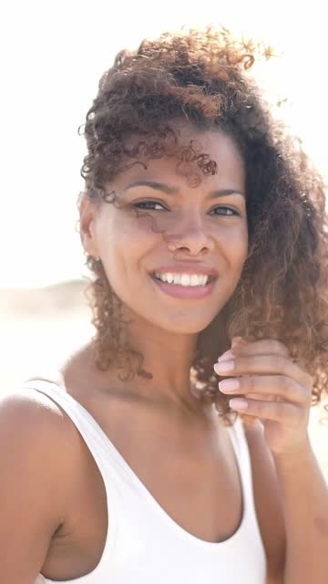 close-up happy african ethnicity woman at sunlight - windswept stock videos & royalty-free footage