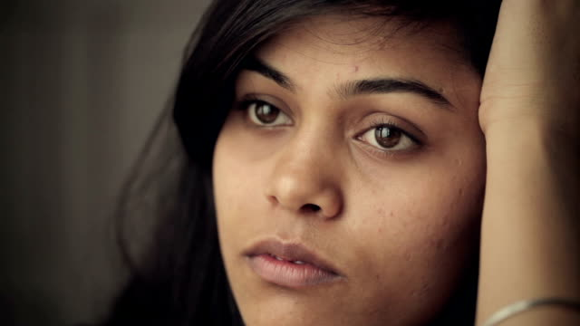 close-up headshots of serene young woman thinking. - indian ethnicity stock videos and b-roll footage