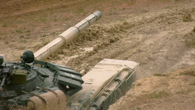 close-up -  heavy tank passes a deep moat with water - moat stock videos & royalty-free footage