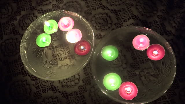 close-up, high angle, colored tea lights floating in water, india - medium group of objects stock videos & royalty-free footage