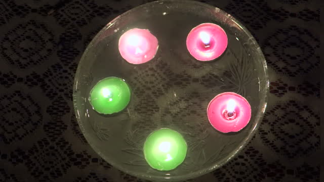 close-up, high angle, colored tea lights floating in water, india - five objects stock videos & royalty-free footage