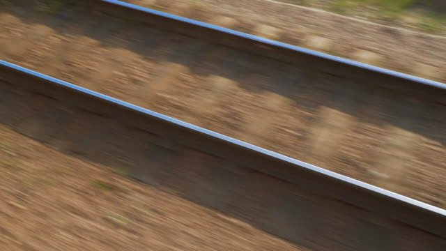 vidéos et rushes de close-up: high angle view of empty railroad track during sunny day - ulaanbaatar, mongolia - élevé