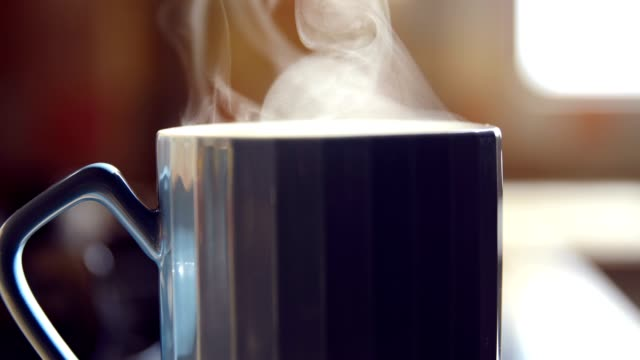 close-up hot cup with steam - coffee cup stock videos & royalty-free footage