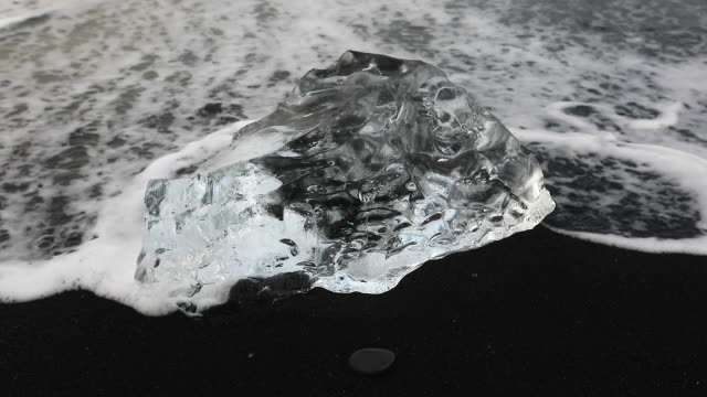 close-up: ice weathered by waves of the ocean - ice crystal stock videos and b-roll footage