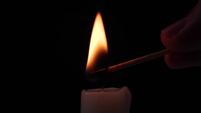 close-up igniting a candle - candlelight stock videos & royalty-free footage
