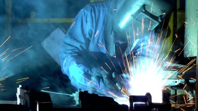 close-up industrial worker welding car part in factory - protective mask workwear stock videos and b-roll footage