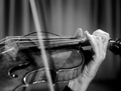 1951 Close-up Jascha Heifetz playing violin during performance/ USA