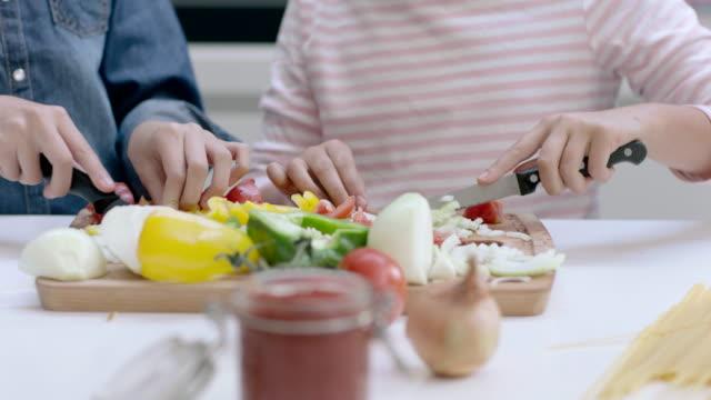 Close-up kids hands preparing a meal