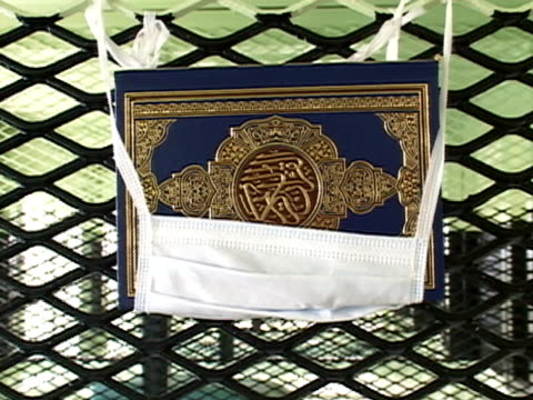 closeup koran hanging in surgical mask on prison cell grate at guantanamo bay detention center/ guantanamo province cuba - surgical mask stock videos & royalty-free footage