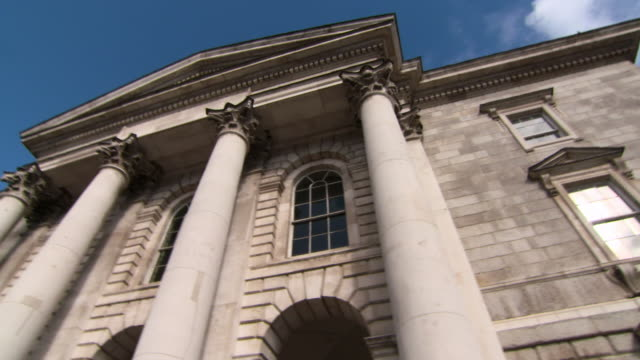 close-up: large pillars on the front of a building in dublin, ireland - architectural column stock videos & royalty-free footage