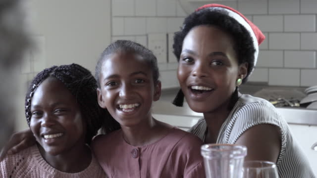 close-up, laughing african american family at christmas - part of a series stock-videos und b-roll-filmmaterial