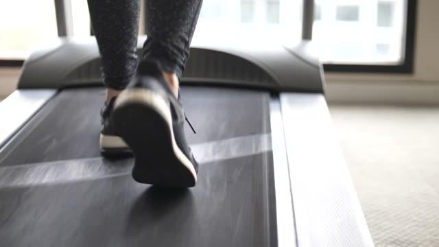 close-up leg of athlete running on treadmill - treadmill stock videos & royalty-free footage