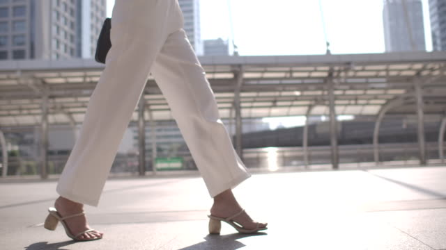 close-up leg of businesswoman walking to commuting to work - human foot stock videos & royalty-free footage