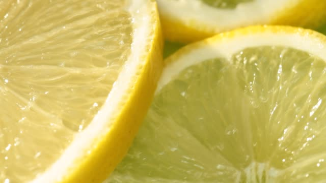 close-up lemon slices - lemon stock videos & royalty-free footage