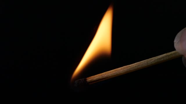 close-up lighting a match, slow motion - igniting stock videos & royalty-free footage