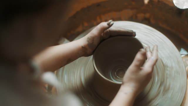 close-up, little girl using pottery wheel at atelier - craftsman stock videos and b-roll footage