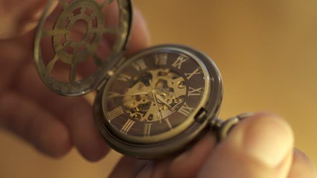close-up lockdown of person holding pocket watch - zurich, switzerland - pocket watch stock videos & royalty-free footage
