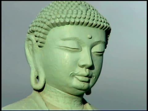 close-up lockdown view of the face on a buddha statue. - female likeness stock videos & royalty-free footage