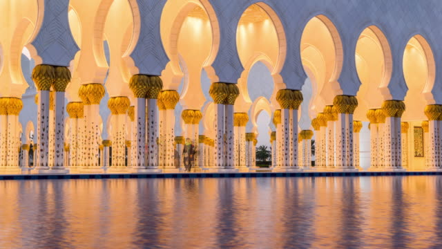 close-up look of dubai mosque illuminated transition - unity stock videos & royalty-free footage