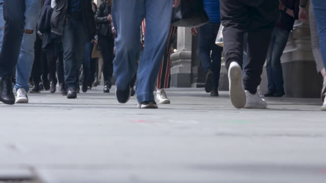 close-up, low angle shoppers on oxford street. - crossing stock videos & royalty-free footage
