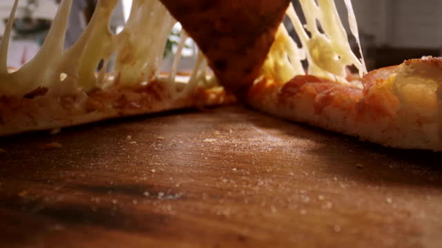 close-up low angle view of a pizza slice being lifted - slice stock videos & royalty-free footage