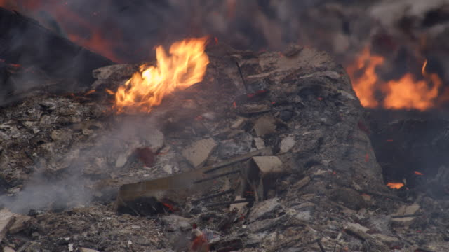 close-up low flames burning in ash-covered rubble after a structure fire - myrtle creek stock videos & royalty-free footage