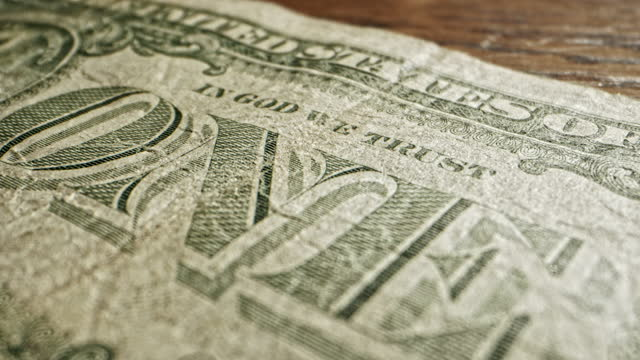 close-up macro dolly shot of the back of a 2009 us american one dollar bill - 2009 stock videos & royalty-free footage