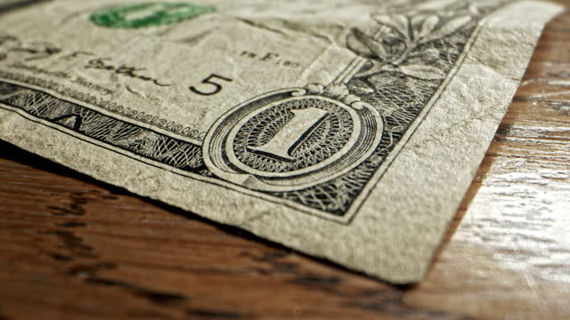 close-up macro dolly shot of the edge of a 2009 us american one dollar bill - 2009 stock videos & royalty-free footage