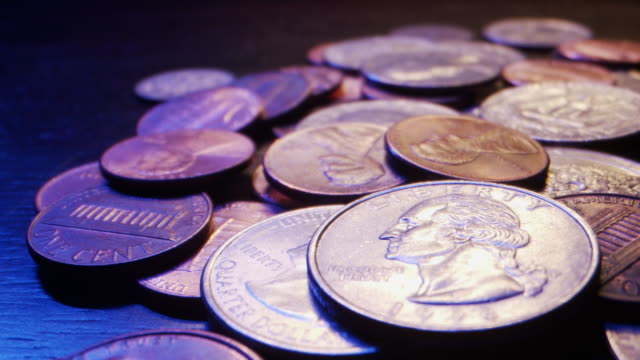 close-up macro moving slider shot of a pile of american currency coins - coin stock videos & royalty-free footage