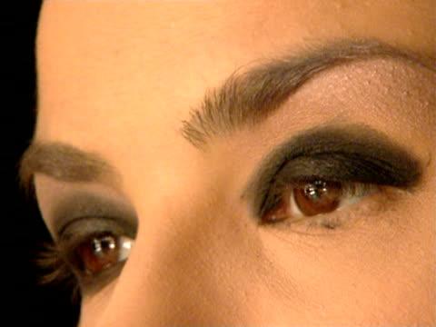 Close-up Makeup artist applying eyeshadow on fashion model/ Belgrade, Serbia