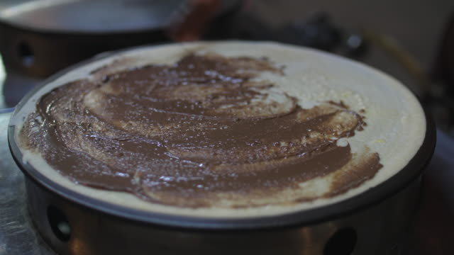 close-up making a crepe dessert in night market street food - crepe stock videos & royalty-free footage