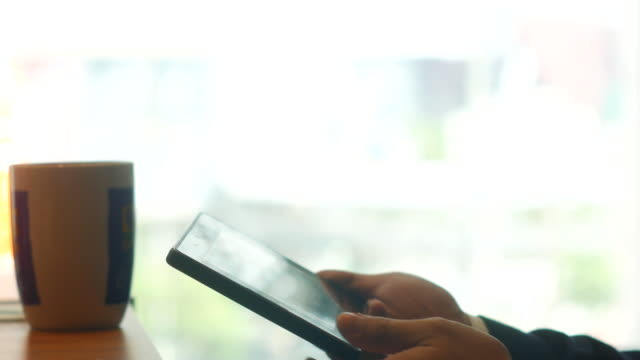 Close-up making transaction by Tablet