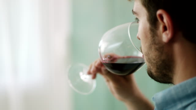 Close-up, man drinking red wine