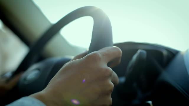 close-up man driving car - steering wheel stock videos & royalty-free footage