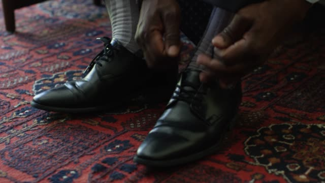 close-up, man ties dress shoes - scarpe video stock e b–roll